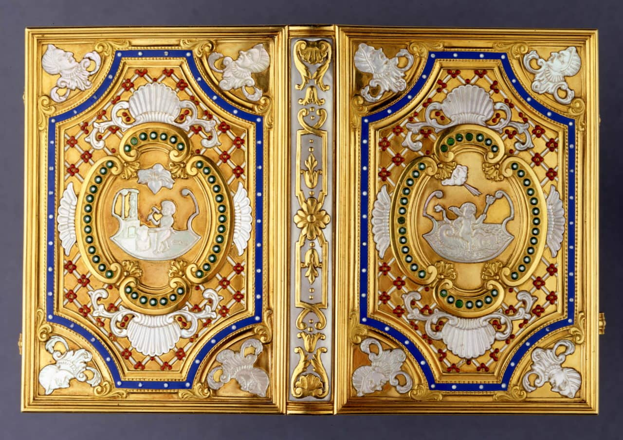 Late 19th century ivory notebook, with three ivory leaves between covers decorated in gold