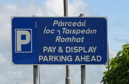 Irish Gaelic road sign showing Tironian et and ampersand
